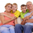 Stock Photo: Grandparents and grandsons on white