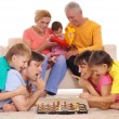Family playing chess — Stock Photo #10937153