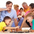 Stock Photo: Family playing chess