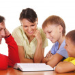 Stock Photo: Parents and sons reading