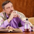 Stock Photo: Mdrinks whiskey and reading