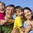 Happy Caucasian mom and father together with his sons play the f — Stock Photo