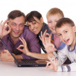 Happy family with laptop — 图库照片