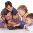 Happy family and laptop — Stock Photo