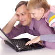 Dad with son at laptop — Stock Photo