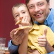 Royalty-Free Stock Photo: Man and son with pizza
