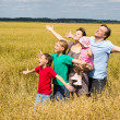 Cute family at field — Stock Photo #10938394