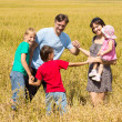 Family at field — Stock Photo