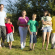 Stock Photo: Caucasian happy family of seven is on the path