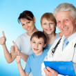 Beautiful Caucasian elderly doctor with a patient — Stock Photo #10939873
