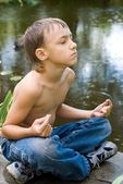 Young little boy meditating — Stock Photo