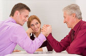 Opponents at table — Stock Photo