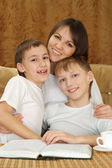 A beautiful Caucasian joy mother with two adorable brothers — Stock Photo