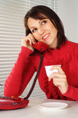 Beautiful Caucasian woman with a phone and a cup — Stock Photo