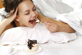 Luck girl lying in bed — Stock Photo