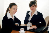 Two business women sitting — Stock Photo