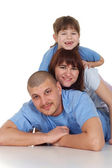 Family lying on each other — Stock Photo