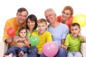 Happy family at sofa — Stock Photo