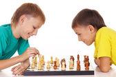 Boys playing chess — Stock Photo