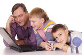 Dad and sons at computer — Stock Photo