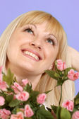 Portrait of a beautiful blonde Caucasian good lady with flowers — Stock Photo