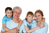 Happy Caucasian grandparents with good children fooled — Стоковое фото