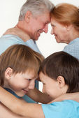 Happy Caucasian grandparents with nice children fooled — Stock Photo