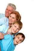 Happy mercy grandparents with grandchildren fooled — Stock Photo