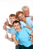 Happy joy grandparents with grandchildren fooled — Stock Photo