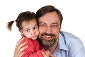 Beautiful Caucasian caring papa holding his daughter in his arms — Stock Photo
