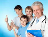 Beautiful Caucasian elderly doctor with a patient — Stock Photo