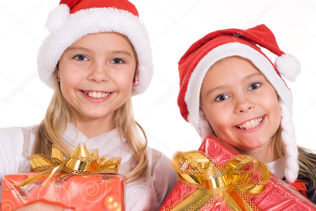 Little girls in celebratory costumes holding a box — Stock Photo #10934437