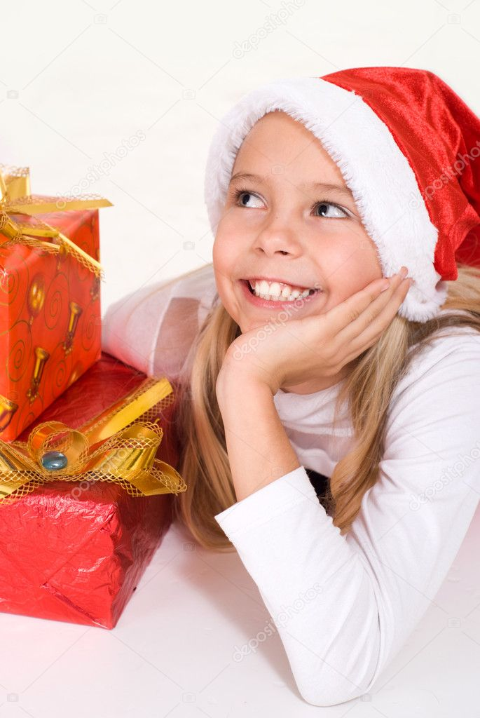 Portrait of little happy girl in Santa's hat  Stock Photo #10934442