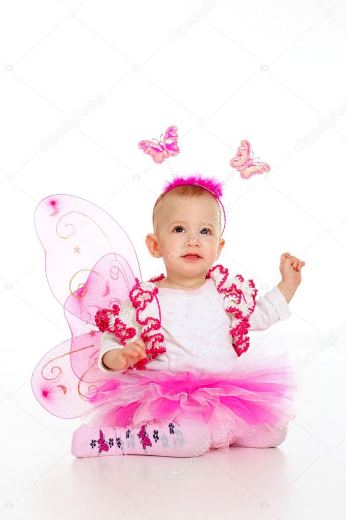 Girl dressed as a butterfly on a light background — Stock Photo #10935359