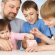 A beautiful adult Caucasian father with children — Stock Photo