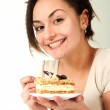 Young Caucasian woman sitting in bed with a cake — Stock Photo #10940184