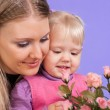 Pretty Caucasian mom and daughter with flowers — Stock Photo #10940288