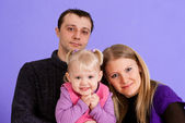 Happy family of three — Stockfoto