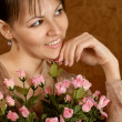 Beautiful Caucasian woman with a flower - Stock Photo