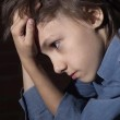 Caucasian child frustrated sitting — Stock Photo #11109500