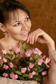 Beautiful Caucasian woman with a flower — Stock Photo