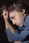 Caucasian child frustrated sitting — Stock Photo
