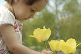 A good Caucasian baby in flowers — Stock Photo