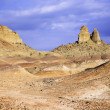 Xinjiang, china: rock formation in qitai ghost town — Stock Photo #13955632