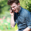 Young man angry on telephone — 图库照片