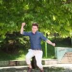 Jumping red hair man — Stock Photo