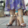 Female feet on the street — Stock Photo