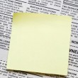 Newspaper and sticky note — Stock Photo #10775062
