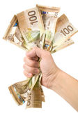 A hand full of canadian dollars — Stock Photo