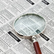 Classified Ad and magnifying glass — Stock Photo
